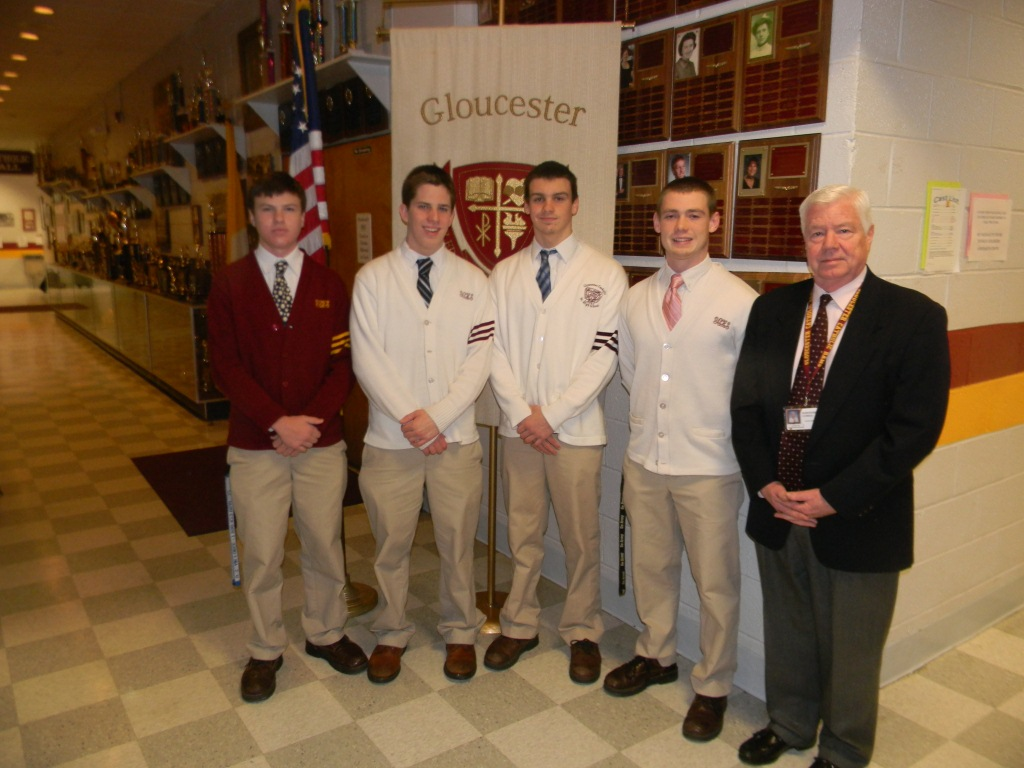 Left to Right: Rory McPeak, Devin McCall, Nicholas Marks, and Brandon Wethman are congratulated by Principal John Colman on their nominations to military academies by local Congresssional representatives.