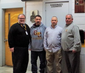 New GCHS Ice Hockey Coach Tom Bunting (second from right) is welcomed by (L to R): Gloucester Catholic Principal Ed Beckett, former coach Guy Gaudreau, and Athletic Director Pat Murphy.