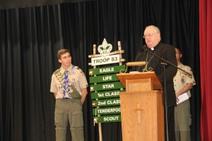 Bishop Dennis Sullivan Honors Tino Capone as an Eagle Scout.