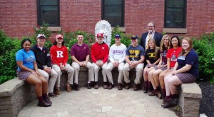 L to R are: Naiyana Sabb (Holy Family), Chris Colman (Rutgers-Camden), Aiden Ward (Rutgers-Camden), Dino Buffeta (Widener), Sean Ward (Rutgers-Camden), Colin Corrado (DeSales), Neil McGee (Lycoming), Julia Kohout (Ursinus), Cassie Hickman (Philadelphia U.), Haley Finley (Arcadia), and Renee DeAngelis (Immaculata). They are congratulated by Mr. Beckett, Principal.