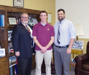 Michael Zelinski (center) is congratulated by Mr. Beckett and Mr. Chzranowski on his selection for the Lutzie 43 Foundation Scholarship, announced earlier this month.