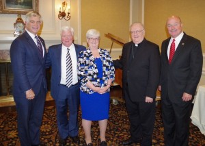 L to R: Patrick Harker '77, John Colman, Mary Boyle, Bishop Dennis Sullivan, and Sen. Fred Madden.